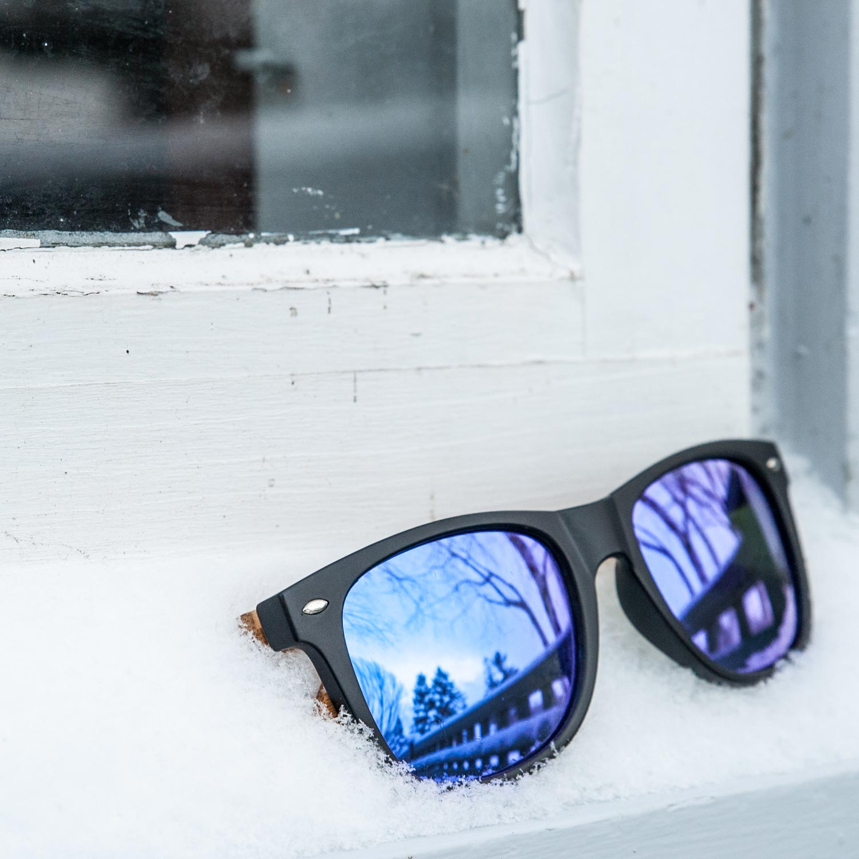 Bamboo wood wayfarer sunglasses blue lenses outdoors