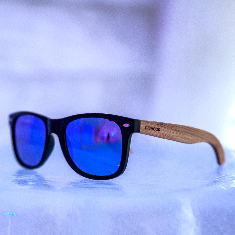Bamboo wood wayfarer sunglasses blue lenses indoors