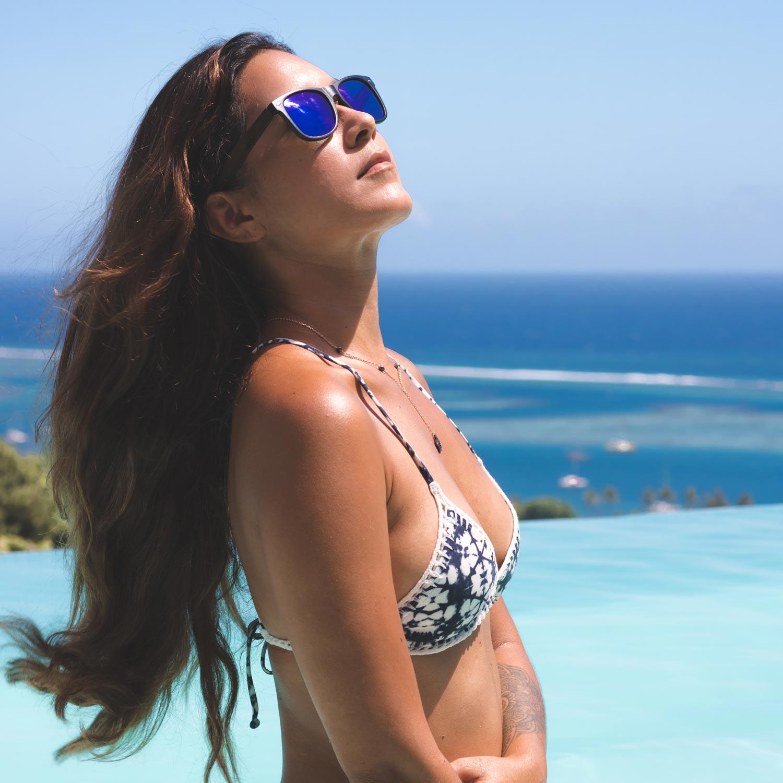 Walnut wood wayfarer sunglasses blue lenses on women