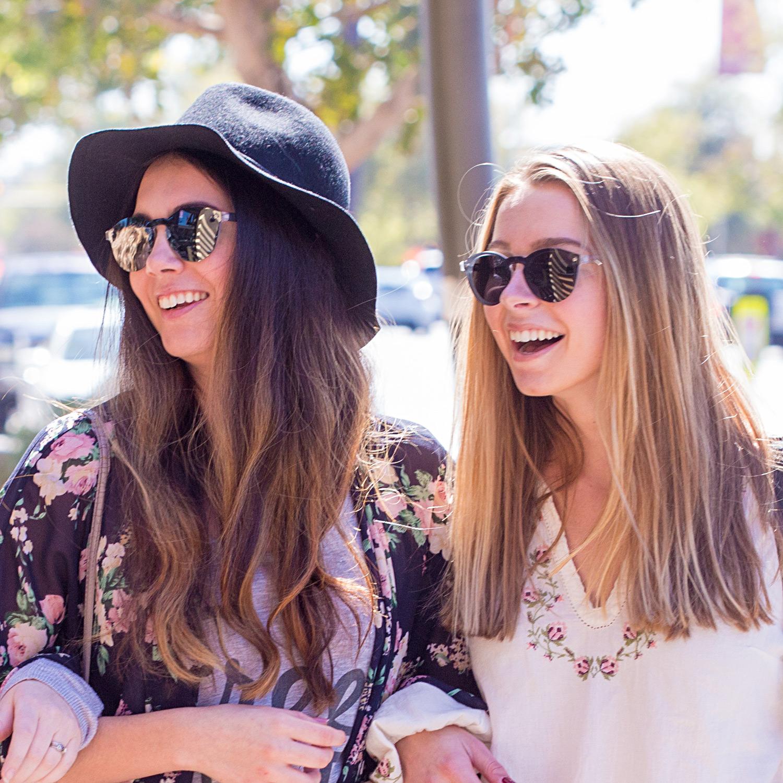 Round ebony wood sunglasses black polarized lenses on women
