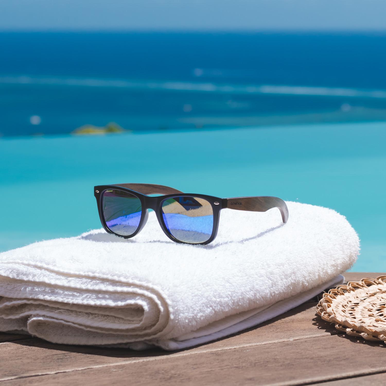 Ebony wood wayfarer sunglasses blue lenses outdoors