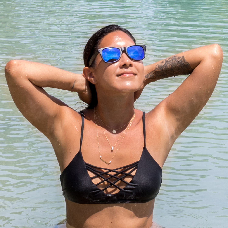 Ebony wood wayfarer sunglasses blue lenses on women